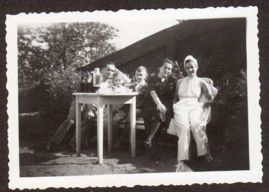 A picture of my grandmother with family and friends