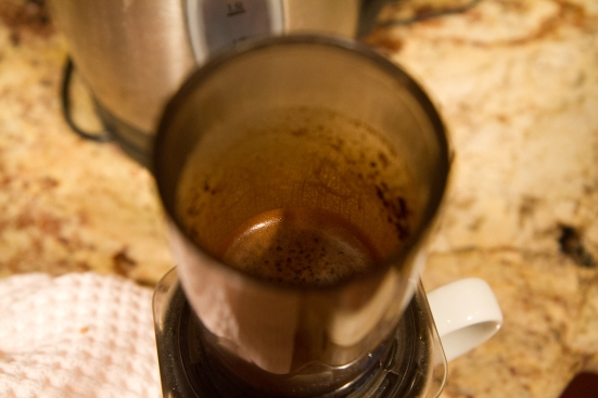 Coffee grounds and water in AeroPress